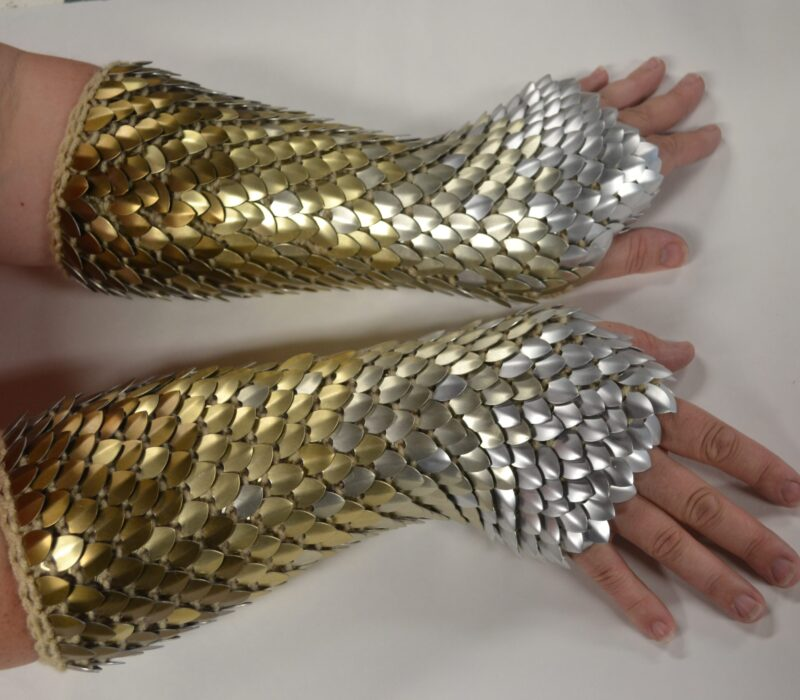 Bronze to silver long knitted dragonhide gauntlets, with the colored scales making a gradient along the sleeves