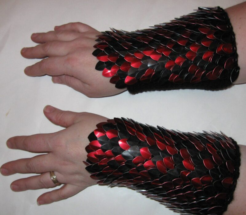 Red and black knitted scalemaille arm warmers