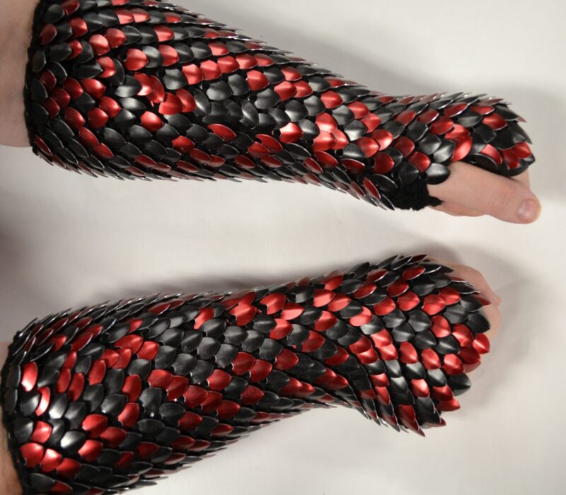 Long black and red wrap-around scalemaille gauntlets on black yarn