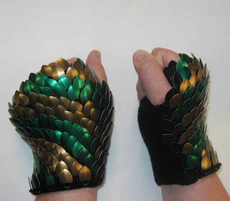 SHort bronze and green scalemaille gauntlets on black yarn