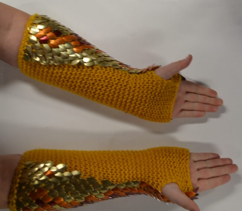 Palm view of a long pair of phoenix scalemaille gauntlets, showing the soft gold yarn lining