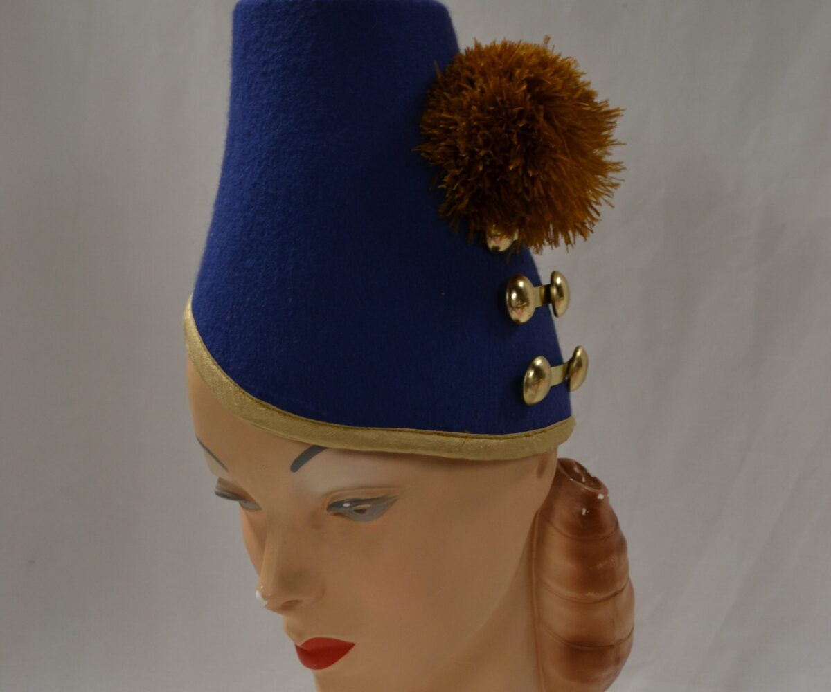A tall blue hat with gold trim, buttons, and puff.