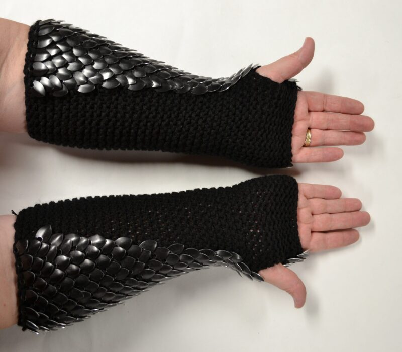 Long black scalemaille gauntlets showing the soft black yarn palm side