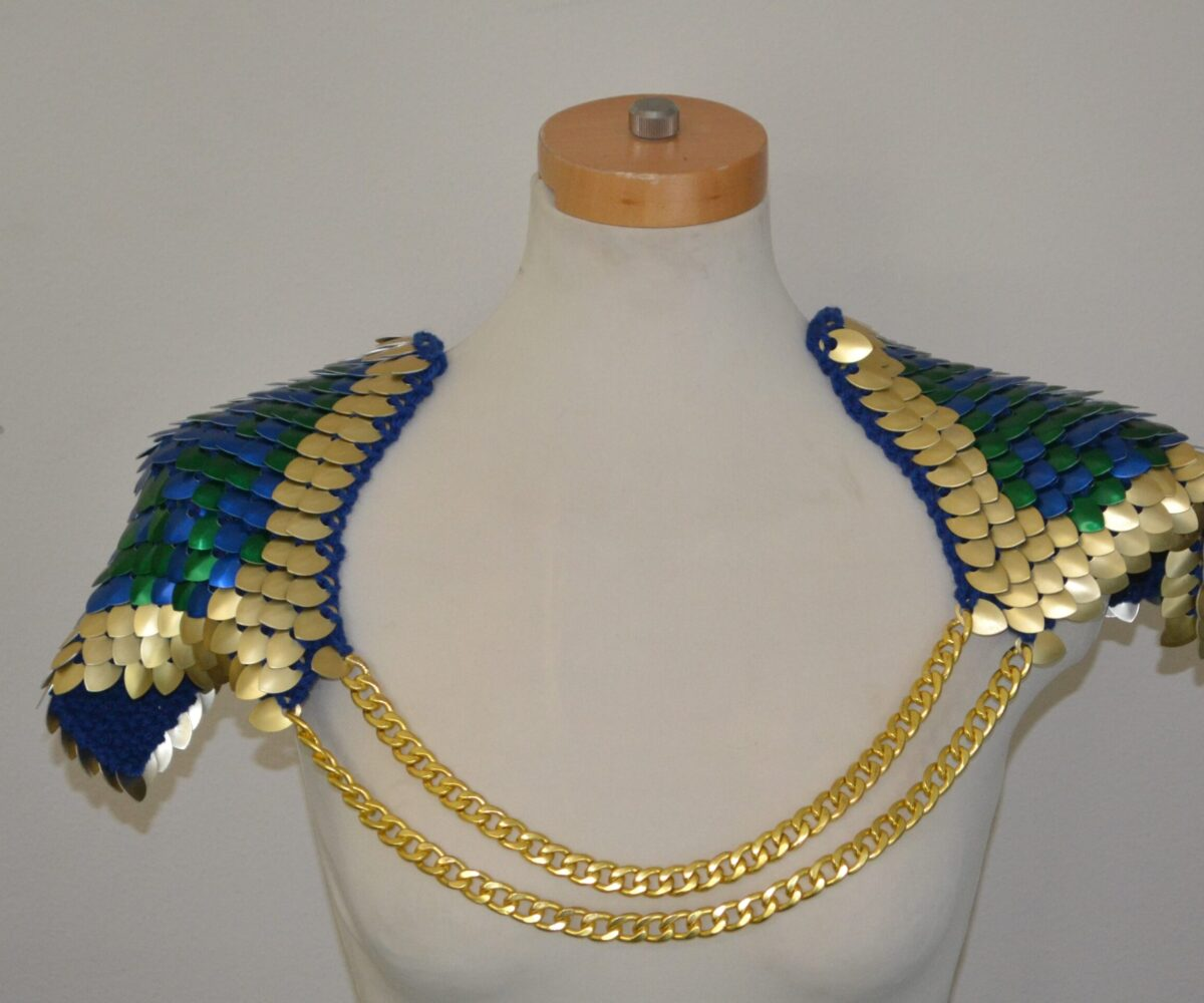 Large blue and green scalemaille epaulets with a gold border and double gold chains connecting both shoulders