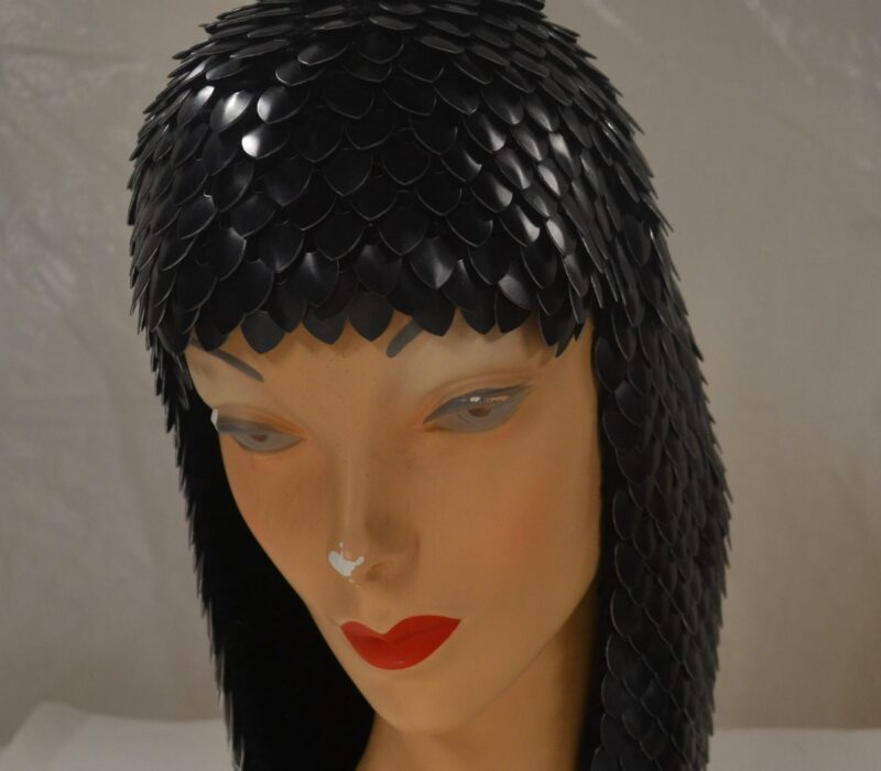 A black knitted scalemaille hood