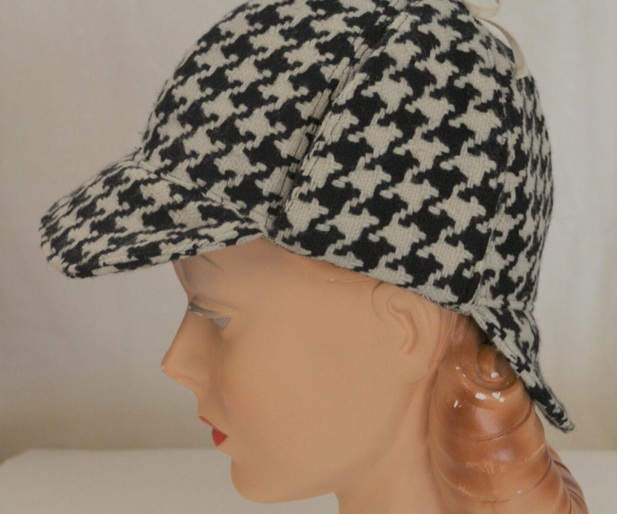 A black and white patterned deerstalker hat