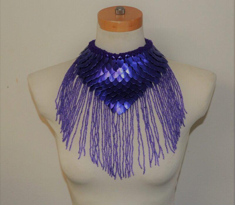 A blue dragonhide collar with cascading blue trim.