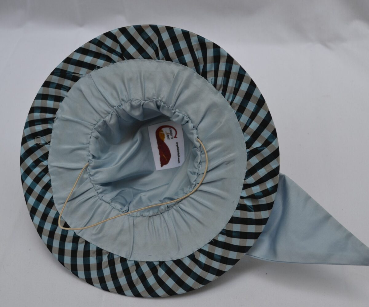 The inside view of a gingham-patterned hat with light grey riibbon and matching lining, as well as an elastic band.
